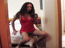Nikki red dress. Excited tranny Nikki posing in hot red dress