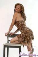 Beyonce fashion. Beyonce Fashion photoshoot posing with a nice dress hiding her fat tool