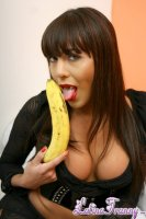 Salma. Latina ladyboy eating a banana and comparing size with her dick