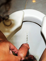Nikki piss at toilet. Dirty tranny Nikki taking a urine